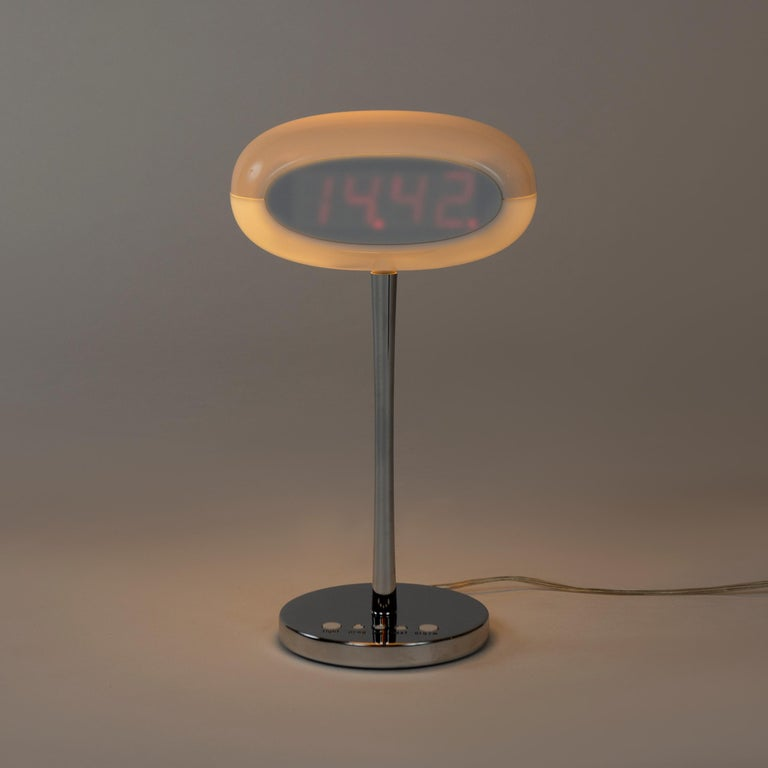 The 'Time and Space' clock lamp, a multifunctional design in aluminum and plastic, from the Driade collection. Designed in 2003. Marked.