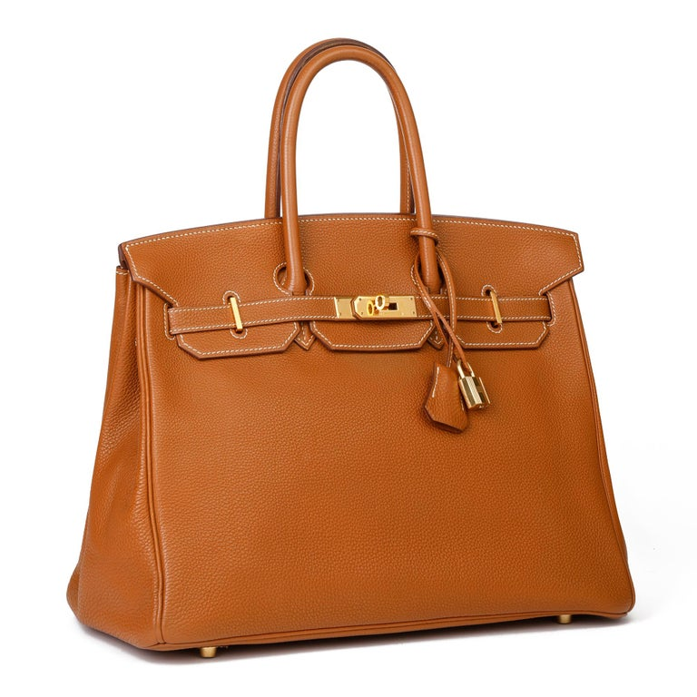HERMÈS Gold Togo Leather Birkin 35cm  Xupes Reference: CB289 Serial Number: [G] Age (Circa): 2003 Accompanied By: Hermès Dust Bag, Lock, Keys, Clochette Authenticity Details: Date Stamp (Made in France)  Gender: Ladies Type: Tote  Colour: