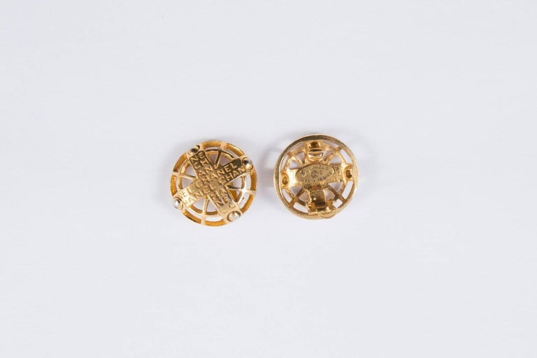 2003s Chanel gold-tone metal earrings featuring a clip on fastening, logo Chanel , a Chanel back plaque. Diameter: 3cm)  In excellent vintage condition. Made in France.   We guarantee you will receive this gorgeous item as described and showed on