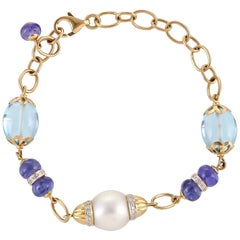 20.04 Carat Blue Topaz Dumbles Tanzanite Beads South Sea Pearl Diamond Bracelet