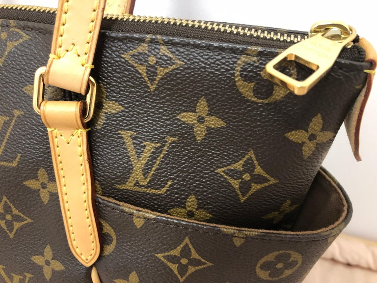 This LV Tote is in great condition with pristine exterior and interior. It was made in France and the serial# is TJ0144. It is very spacious, crafted in monogram coated canvas and vachetta leather straps and trim. the bag has thin but resilient