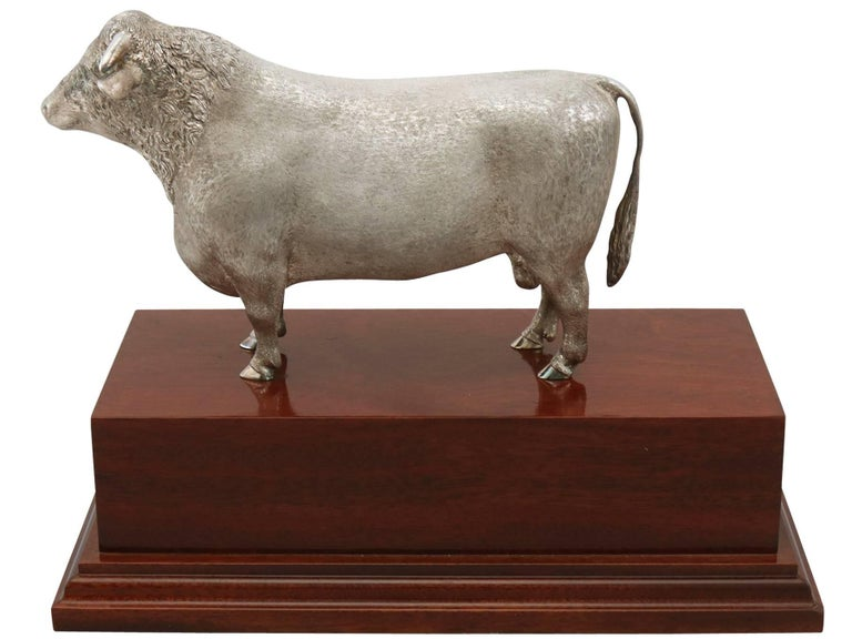 An exceptional, fine and impressive contemporary Elizabeth II English cast sterling silver presentation bull on mahogany plinth; an addition to our animal related silverware collection.  This exceptional contemporary English cast sterling silver