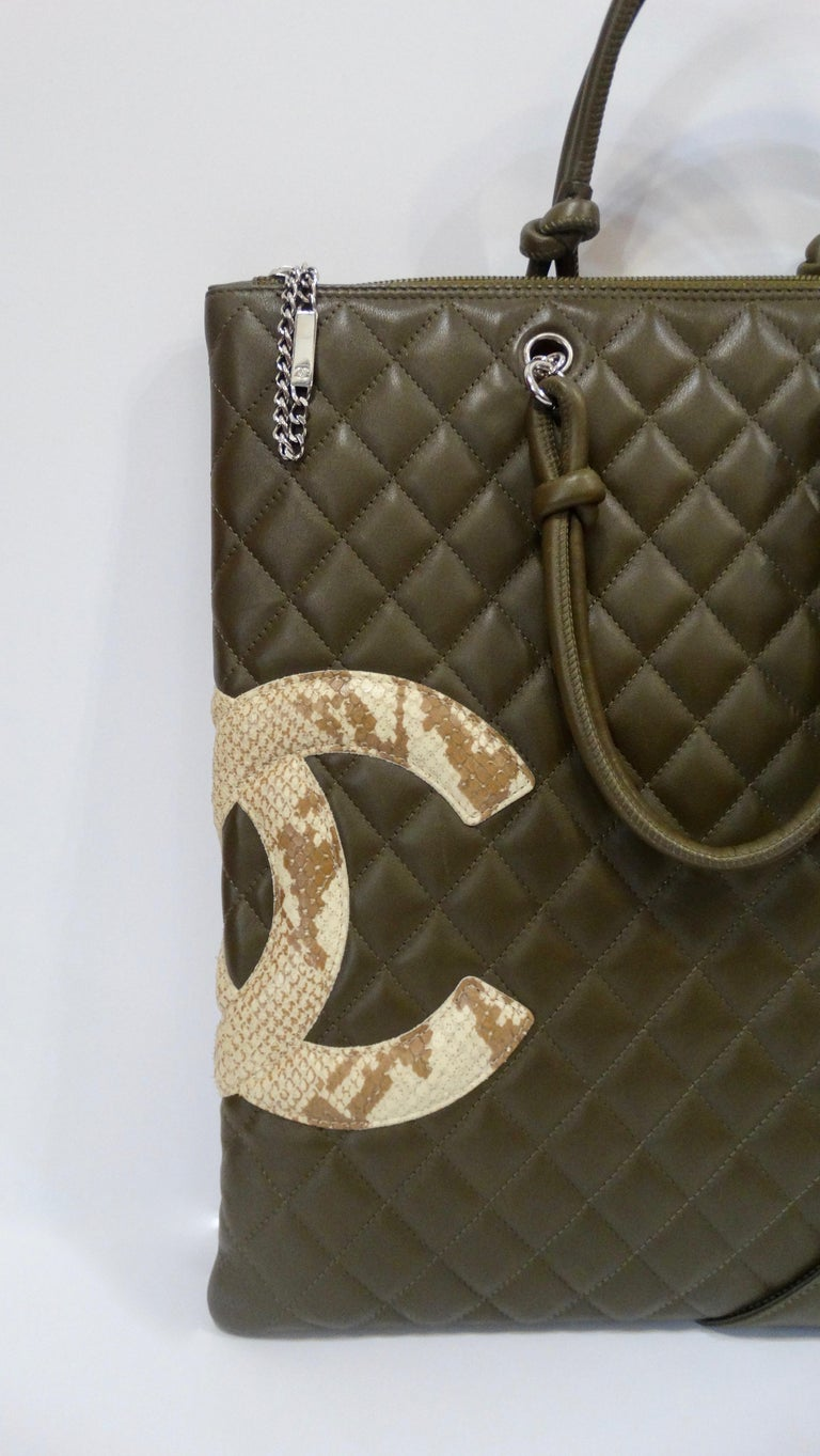 c8253abd7601 2005 Chanel Cambon Olive Green Leather Tote Bag For Sale. Carry around a  piece of Karl Lagerfeld with this Chanel tote bag! Circa 2005,