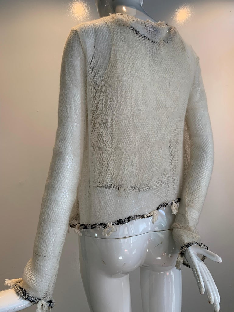 A beautiful gauzy 2005 Chanel summer-weight, 100% cashmere knit tank and cardigan.