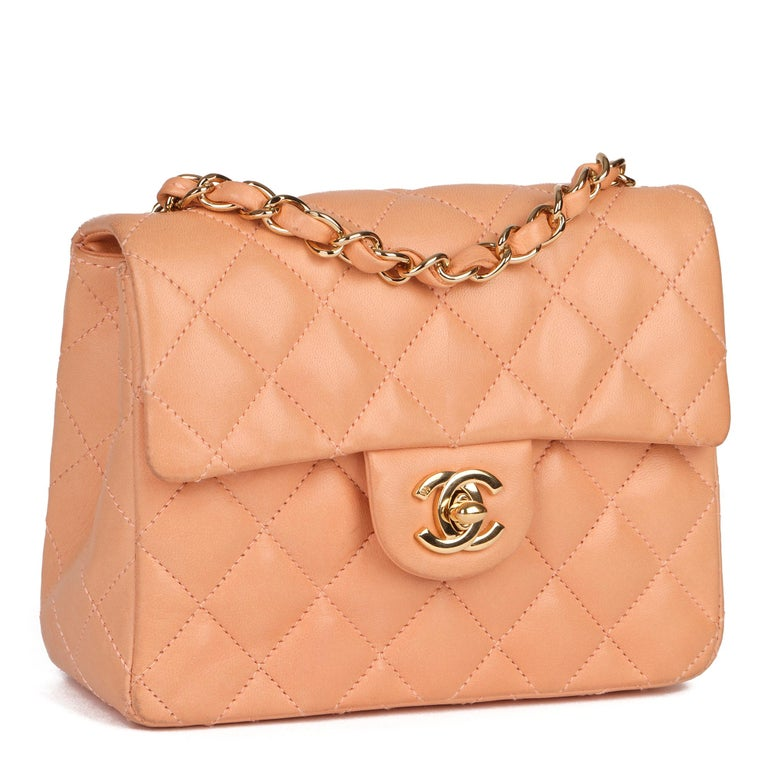 CHANEL Peach Quilted Lambskin Leather Vintage Mini Flap Bag   Xupes Reference: CB294 Serial Number: 9615720 Age (Circa): 2005 Accompanied By: Chanel Dust Bag, Box, Authenticity Card, Care Booklet, Receipt Authenticity Details: Date Stamp (Made in