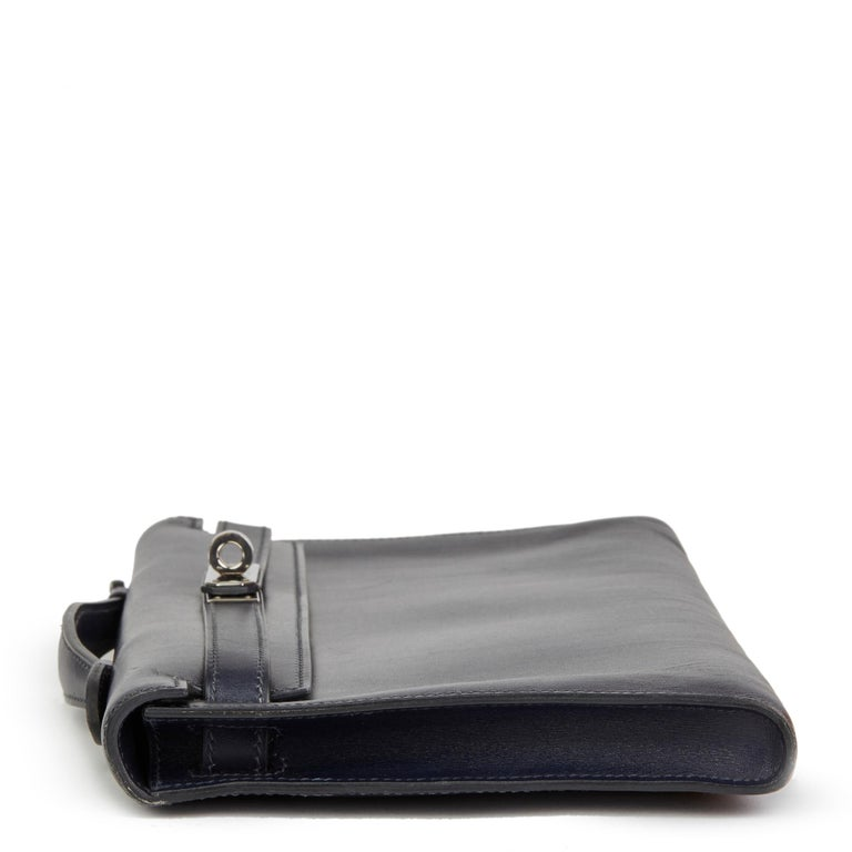 HERMÈS Navy Box Calf Leather Kelly Longue Clutch  Reference: HB2497 Serial Number: [J] Age (Circa): 2006 Accompanied By: Hermès Dust Bag, Box Authenticity Details: Date Stamp (Made in France) Gender: Ladies Type: Clutch, Top Handle  Colour: