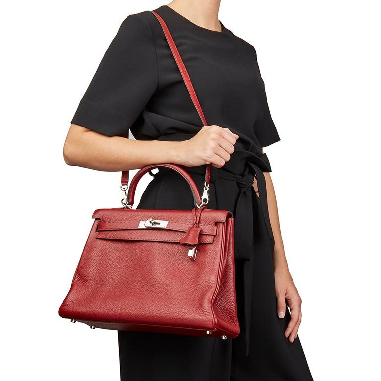 HERMÈS Rouge H Clemence Leather Kelly 32cm Retourne  Xupes Reference: HB2217 Serial Number: [J] Age (Circa): 2006 Accompanied By: Hermès Dust Bag, Box, Lock, Keys, Clochette, Shoulder Strap, Care Booklet Authenticity Details: Date Stamp (Made in
