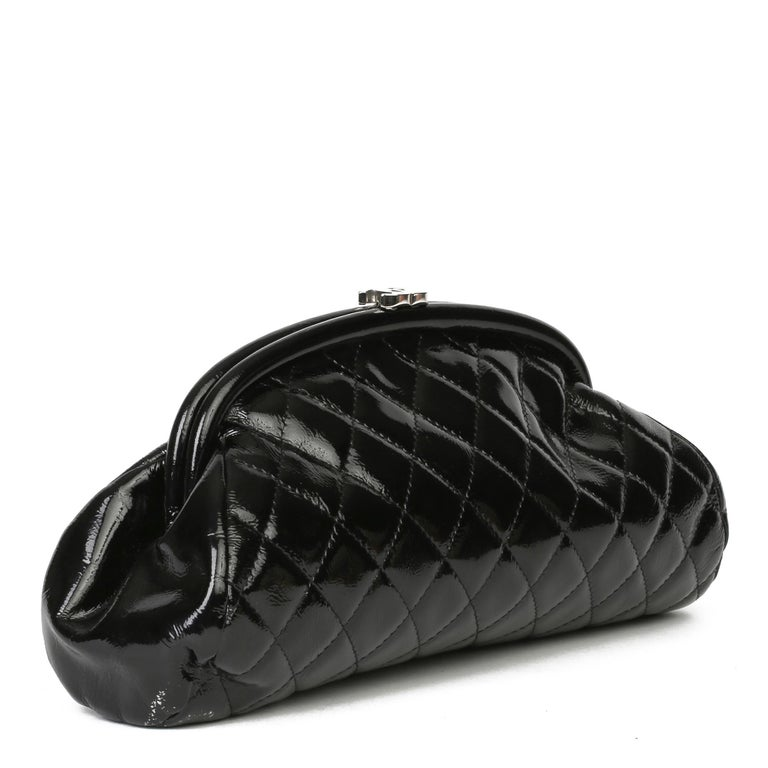 CHANEL Black Quilted Aged Patent Leather Timeless Clutch  Xupes Reference: HB3916 Serial Number: 11057294 Age (Circa): 2007 Accompanied By: Chanel Dust Bag, Authenticity Card Authenticity Details: Authenticity Card, Serial Sticker (Made in