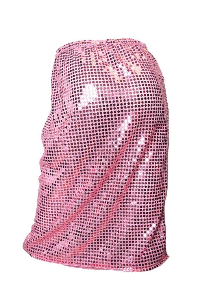 """2007 Comme des Garcons pink sequin skirt , elastic waist, asymmetrical hem.  Condition: Excellent. Size M 28"""" across waist 38""""  hips 26"""" total length"""