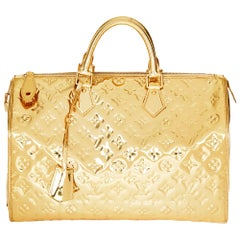 2008 Louis Vuitton Gold Monogram Miroir Vinyl Speedy 35