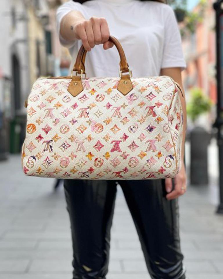 Speedy 35 by Louis Vuitton Aquerelle line in limited edition, made of white leather with pink monogram pattern, cowhide inserts and golden hardware. Equipped with double cowhide handle to wear it comfortably by hand. The product is equipped with a