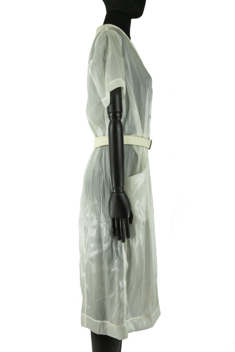 This Marc Jacob for Louis Vuitton shirt dress was featured in the 2008 spring ready to wear collection. Described as a 'chic take on the classic nurses uniform', models wore the sheer organza dresses over garments with matching sheer monogram LV