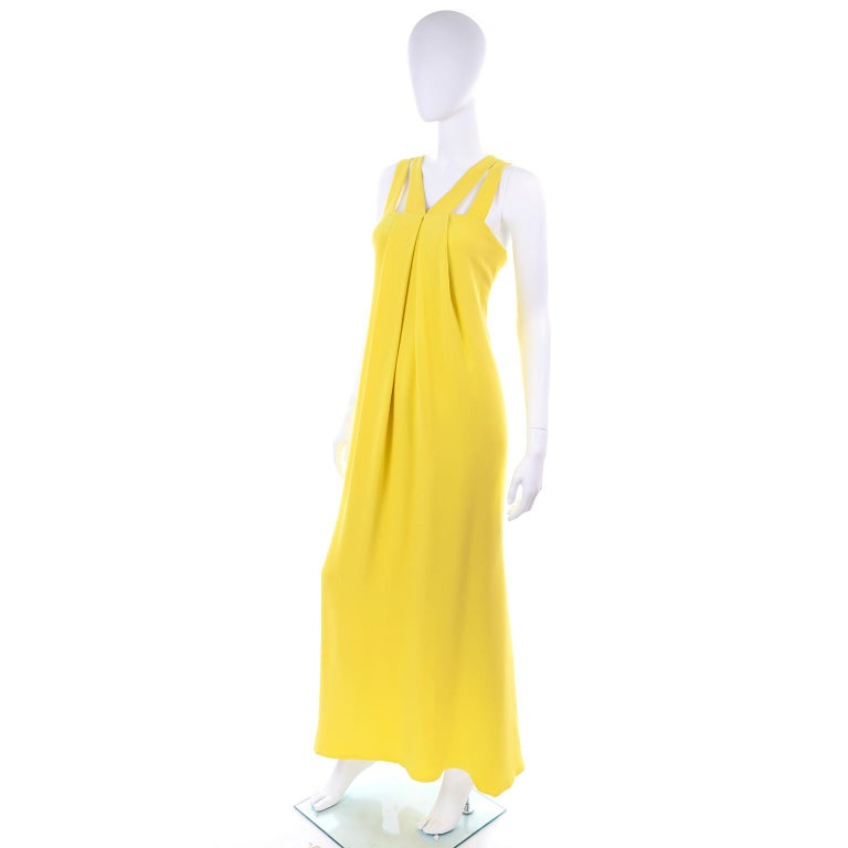 This is a documented dress from Oscar de la Renta's 2008 Resort wear collection.  The dress is in a lovely shade of chartreuse yellow silk and is fully lined. We love the way the dress is cut, the dramatic straps, and the way the inner corset