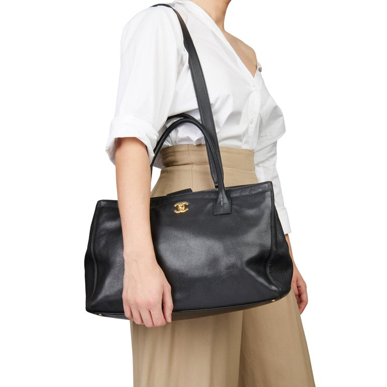 CHANEL Black Calfskin Leather Cerf Tote  Xupes Reference: HB3115 Serial Number: 12328964 Age (Circa): 2009 Accompanied By: Interior Pouch, Shoulder Strap Authenticity Details: Date Stamp (Made in Italy) Gender: Ladies Type: Tote, Shoulder  Colour: