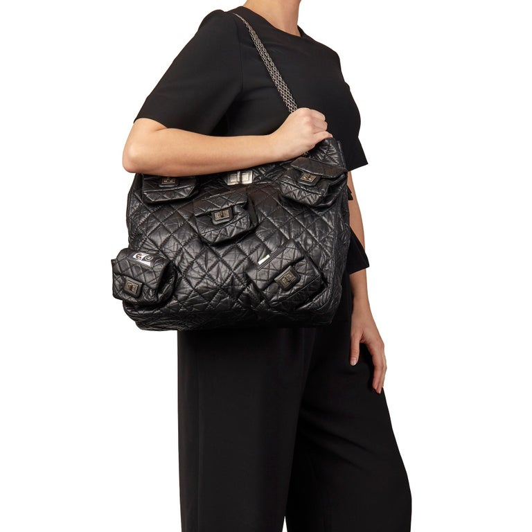 CHANEL Black Quilted Aged Calfskin Leather 5 Pocket Reissue Shoulder Bag   Xupes Reference: HB3163 Serial Number: 12293824 Age (Circa): 2009 Accompanied By: Authenticity Card, Removable Pocket Pocket References Authenticity Details: Serial Sticker,
