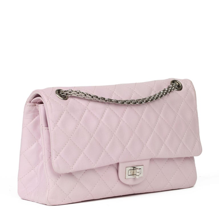 CHANEL Sakura Pink Quilted Lambskin 2.55 Reissue 226 Flap Bag  Xupes Reference: HB3910 Serial Number: 12874722 Age (Circa): 2009 Accompanied By: Chanel Dust Bag, Authenticity Card, Care Booklet, Protective Felt Authenticity Details: Authenticity