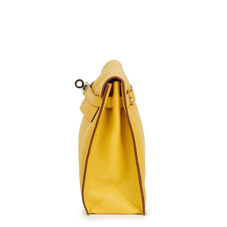 HERMÈS Jaune d'or Swift Leather Kelly Danse  Reference: HB2282 Serial Number: [M] Age (Circa): 2009 Accompanied By: Hermès Dust Bag, Box  Authenticity Details: Date Stamp (Made in France) Gender: Ladies Type: Shoulder, Crossbody, Backpack, Belt
