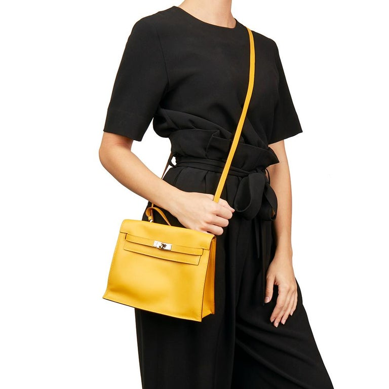 HERMÈS Jaune d'or Swift Leather Kelly Danse  Xupes Reference: HB2282 Serial Number: [M] Age (Circa): 2009 Accompanied By: Hermès Dust Bag, Box  Authenticity Details: Date Stamp (Made in France) Gender: Ladies Type: Shoulder, Crossbody, Backpack,