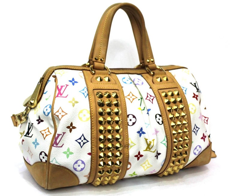 Louis Vuitton multicolor pattern Courtney model. Enriched with golden studs and hardware. Equipped with double handle and removable cowhide shoulder strap. Zip closure, internally very large. It is in excellent condition, year 2009.
