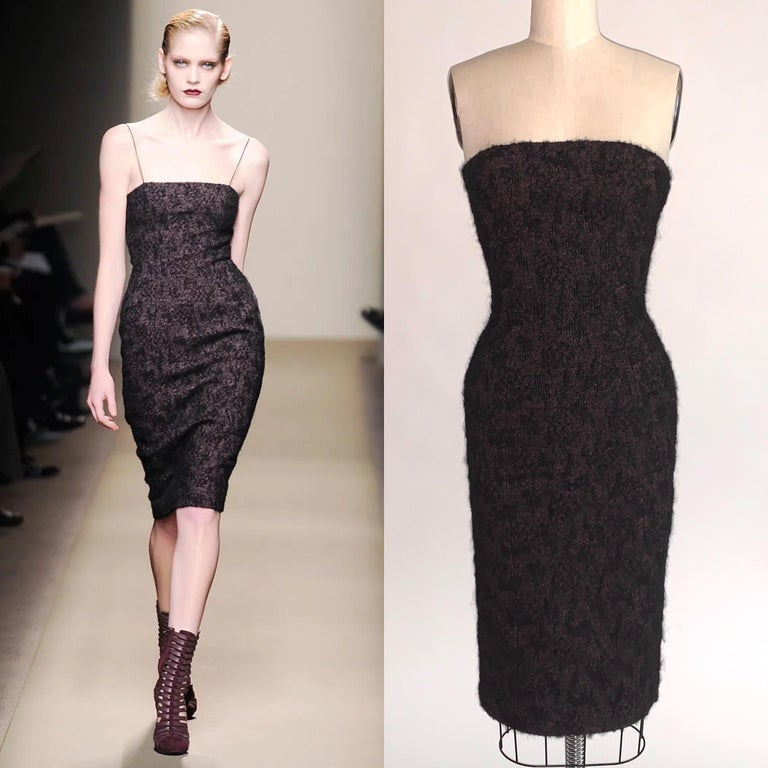 Bottega Veneta black strapless wiggle dress as seen on the Fall 2009 runway, look 14. Black and pink boucle with mohair for a fun fuzzy look. Seam detailing creates a stunning shape- dress is a true