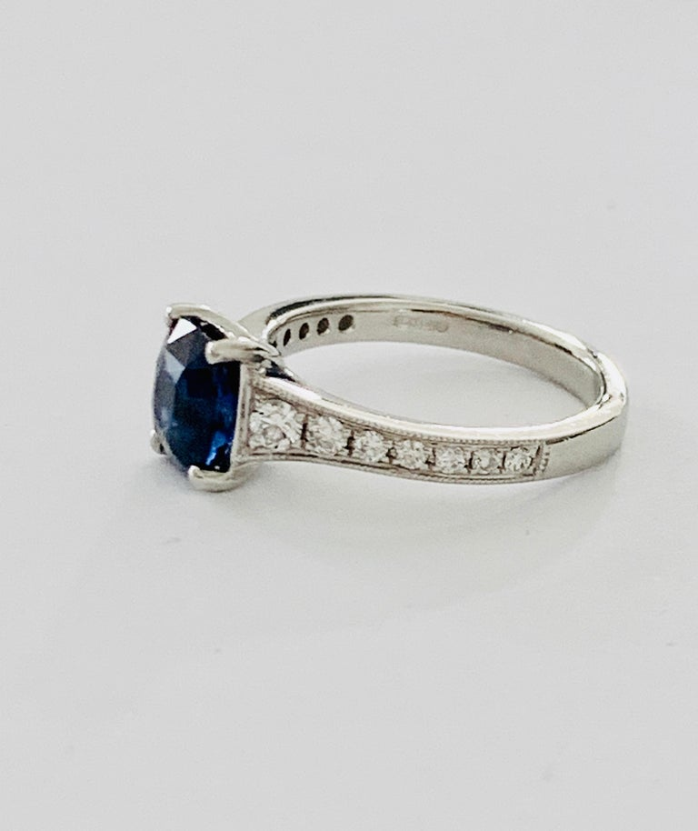 Modern 2.00ct Cushion Cut Blue Sapphire in a Platinum Band Set with 0.24ct of Diamonds For Sale