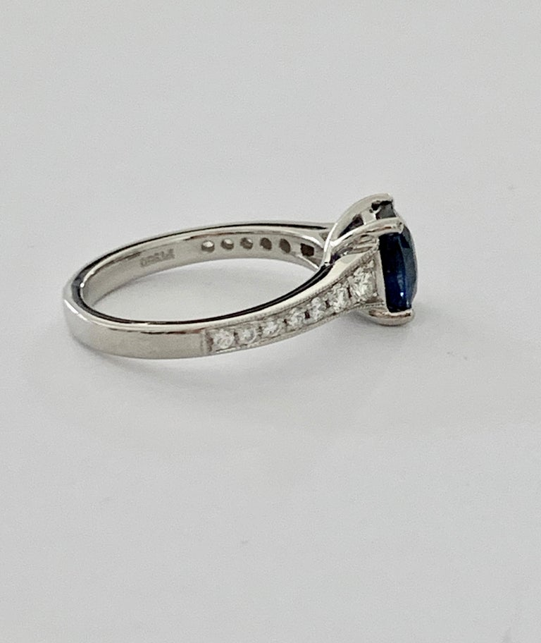 Women's 2.00ct Cushion Cut Blue Sapphire in a Platinum Band Set with 0.24ct of Diamonds For Sale