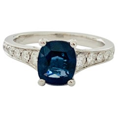 2.00ct Cushion Cut Blue Sapphire in a Platinum Band Set with 0.24ct of Diamonds