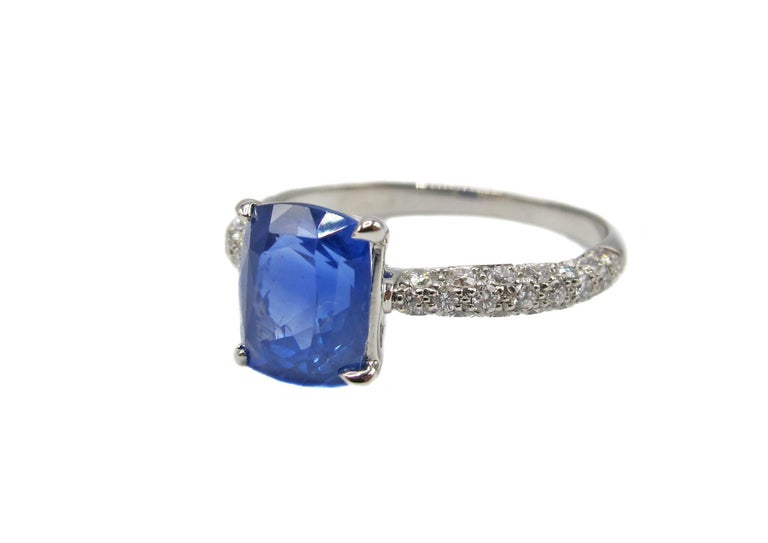 Beautifully hand crafted in platinum, with amazing micro pave setting of the diamonds, this ring is  centrally set with a natural Ceylon sapphire weighing 2.01 carats. The Cornflower blue sapphire, which is eye clean is held by four eagle claw