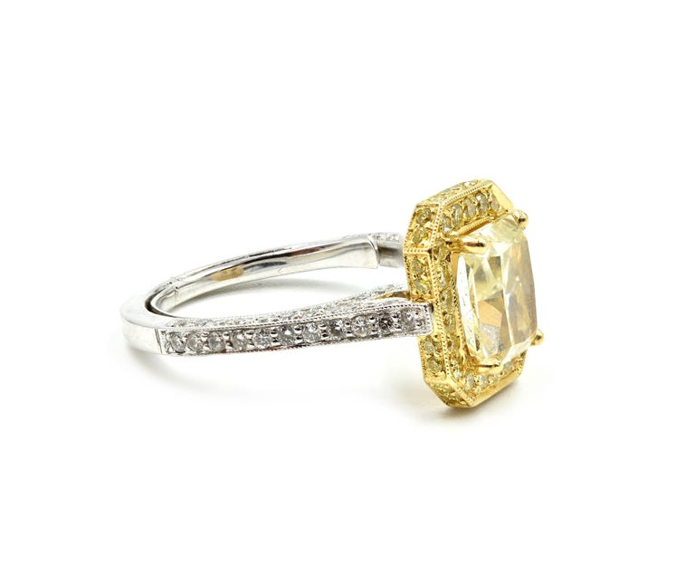 Designer: custom design Material: 18k white and yellow gold Center Stone: 2.01 carat fancy light yellow radiant cut diamond Color: fancy light yellow Clarity: VS1 Diamonds: 1.09 carat weight Color: F-H Clarity: SI1-SI2 Carat Total Weight: 3.10 carat