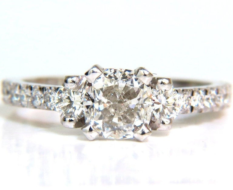 GIA Certified:  1.01ct. Cushion Cut Brilliant diamond ring  Report: 2145777278  I-color  Si-1 clarity    Side diamonds:   French pave artsy details,  1.00ct.   Rounds, Full cuts  F / G color   vs-2 clarity.  Platinum  4 grams.  current size: 6  (we