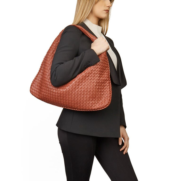 BOTTEGA VENETA Burnt Red Woven Lambskin Medium Veneta Bag   Xupes Reference: HB3382 Serial Number: BO1488512Y Age (Circa): 2010 Accompanied By: Bottega Dust Bag, Mirror Authenticity Details: Date Stamp (Made in Italy)  Gender: Ladies Type: