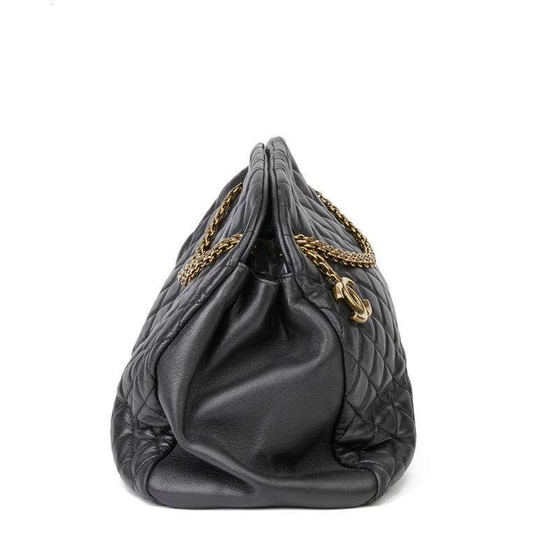 CHANEL Black Quilted Lambskin Large Just Mademoiselle Bowling Bag  Xupes Reference: HB3366 Serial Number: 14158424 Age (Circa): 2010 Authenticity Details: Serial Sticker (Made in Italy) Gender: Ladies Type: Shoulder  Colour: Black Hardware: Antiqued