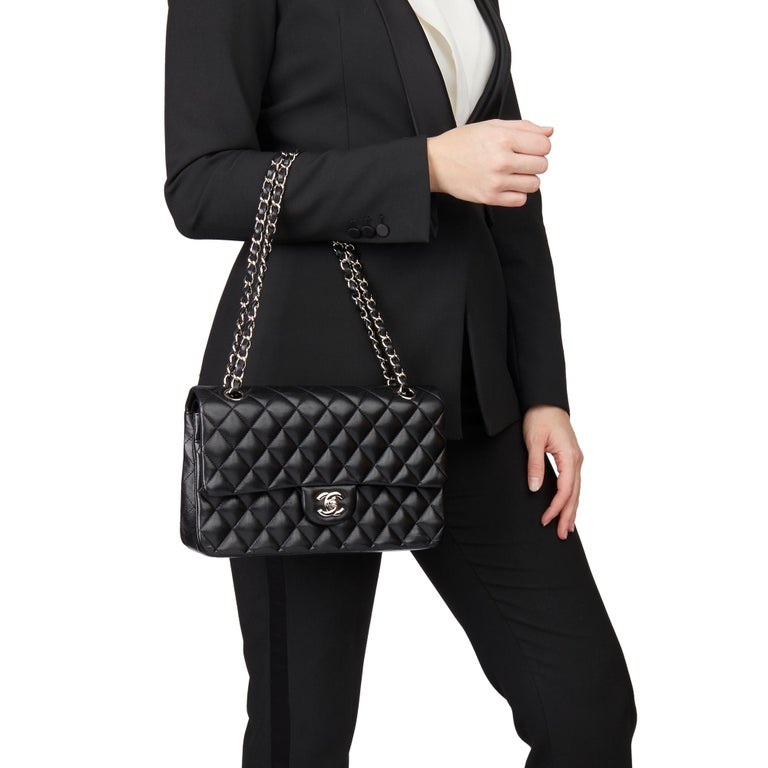 CHANEL Black Quilted Lambskin Medium Classic Double Flap Bag   Xupes Reference: HB3184 Serial Number: 13847468 Age (Circa): 2010 Accompanied By: Chanel Dust Bag, Box, Authenticity Card, Protective Felt, Care Booklet Authenticity Details: Serial