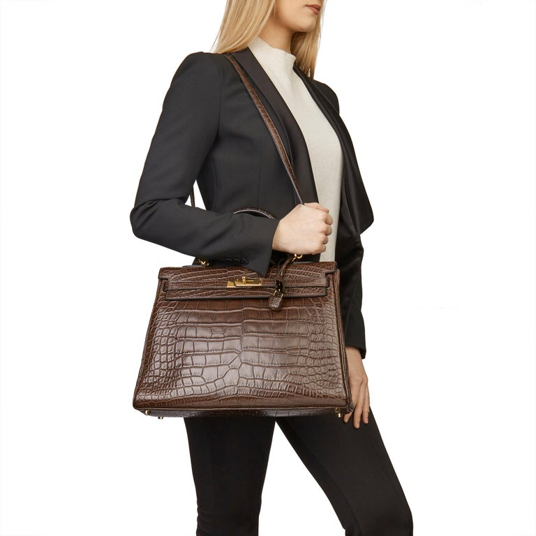 HERMÈS Chocolate Brown Matte Mississippiensis Alligator Leather Kelly 35cm  Xupes Reference: CB181 Serial Number: [N] Age (Circa): 2010 Accompanied By: Hermès Dust Bag, Lock, Keys, Clochette, Shoulder Strap, Copy of CITIES Authenticity Details: Date