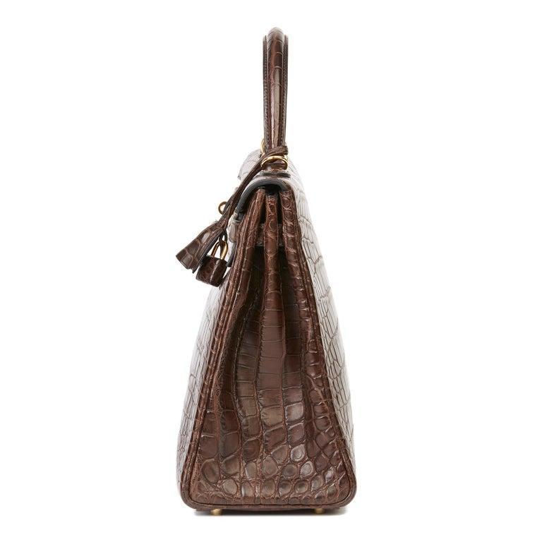 Women's 2010 Hermès Chocolate Brown Matte Mississippiensis Alligator Leather Kelly 35cm For Sale