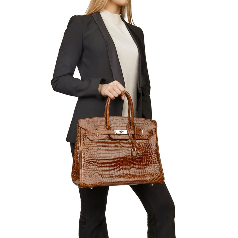 HERMÈS Miel Shiny Porosus Crocodile Leather Birkin 35cm  Xupes Reference: CB182 Serial Number: [N] Age (Circa): 2010 Accompanied By: Hermès Dust Bag, Lock, Keys, Clochette, Copy of CITIES, Rain Cover Authenticity Details: Date Stamp (Made in