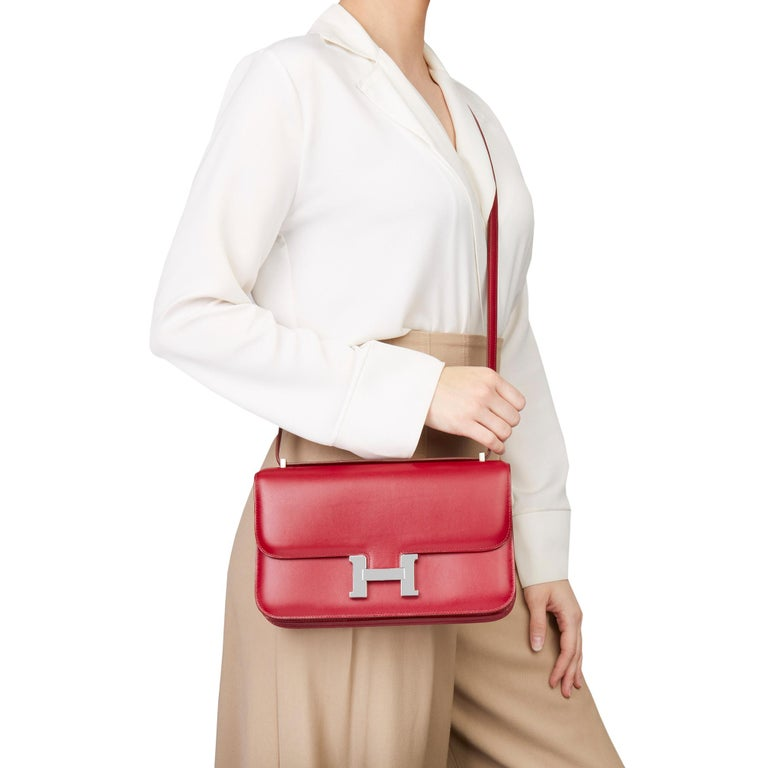 HERMÈS Rubis Tadelakt Leather Constance Elan  Xupes Reference: HB2509 Serial Number: [N] Age (Circa): 2010 Accompanied By: Hermès Dust Bag, Box Authenticity Details: Date Stamp (Made in France) Gender: Ladies Type: Shoulder, Crossbody  Colour: