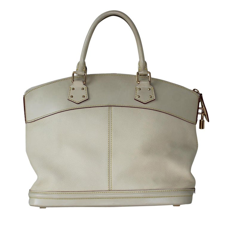 Very chic LV bag 2010 collection Cream color Two handles Golden metal padlock One internal pocket with zip Two additional internal pockets Cm 30 x 39 x 18 (11.81 x 15.35 x 7.08 inches) With dustbag Worldwide express shipping included in the price !
