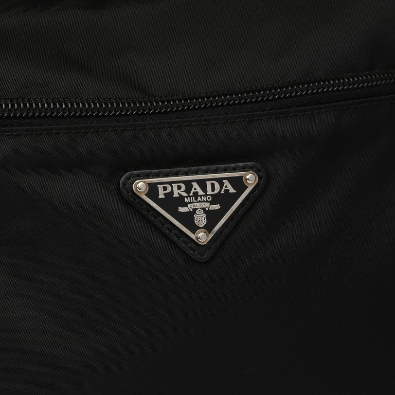 PRADA Black Nylon & Calfskin Leather Camera Bag  Xupes Reference: HB3967 Serial Number: 165 Age (Circa): 2010 Accompanied By: Prada Dust Bag Authenticity Details: Serial Tag (Made in Italy) Gender: Unisex Type: Shoulder, Crossbody  Colour: