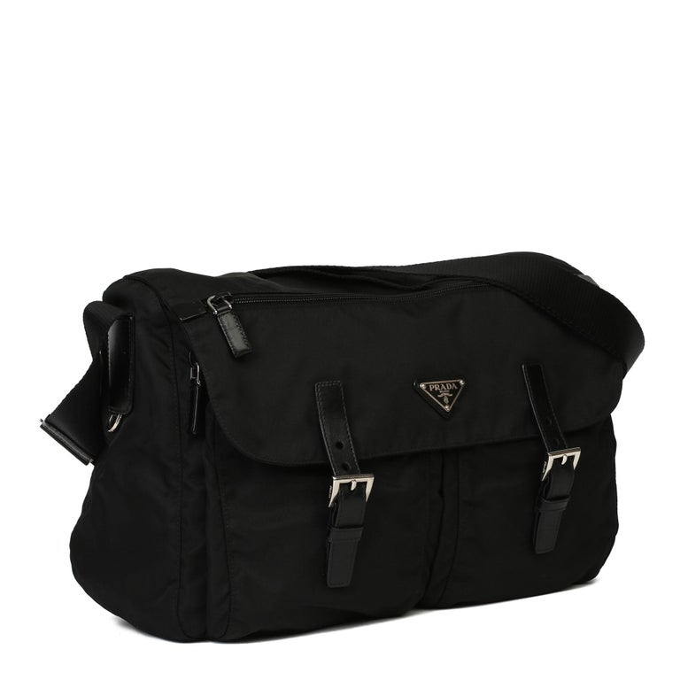 PRADA Black Nylon & Calfskin Leather Medium Shoulder Bag  Xupes Reference: HB3948 Serial Number: 164 Age (Circa): 2010 Authenticity Details: Serial Tag (Made in Italy) Gender: Unisex Type: Shoulder, Crossbody  Colour: Black Hardware: