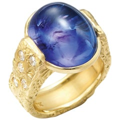 20.11 Carat Oval Cabochon Tanzanite in 18 Karat Gold Textured Band with Diamonds