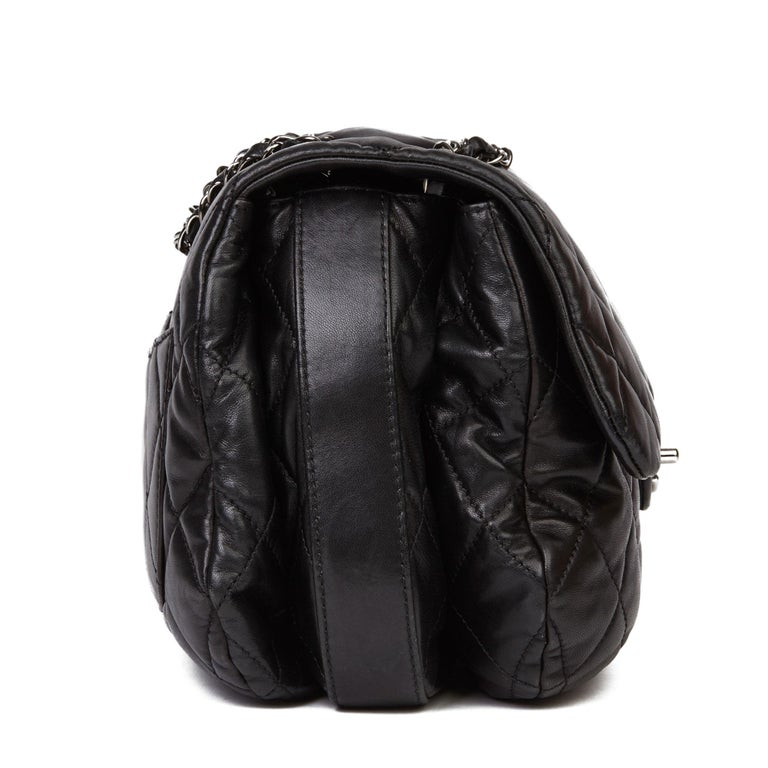 CHANEL Black Quilted Lambskin Triple Compartment Classic Single Flap Bag  Xupes Reference: HB3656 Serial Number: 15358143 Age (Circa): 2011 Accompanied By: Chanel Dust Bag, Authenticity Card  Authenticity Details: Authenticity Card, Serial Sticker