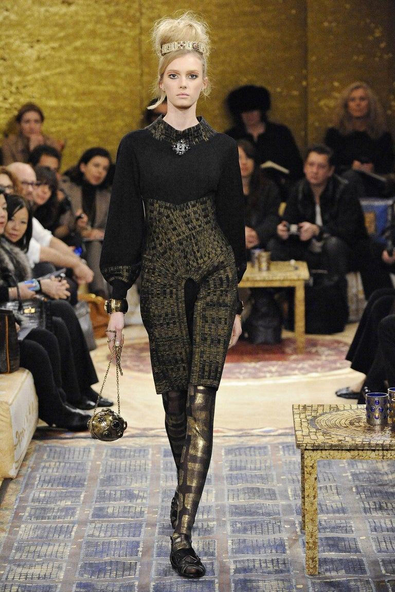 Really hard to find Chanel clutch with crossbody chain from the Paris Byzance Collection Metallic clutch with brown leather lining. Seen in difefrent loks from the runway. Featured in the page 490-491 from the Book