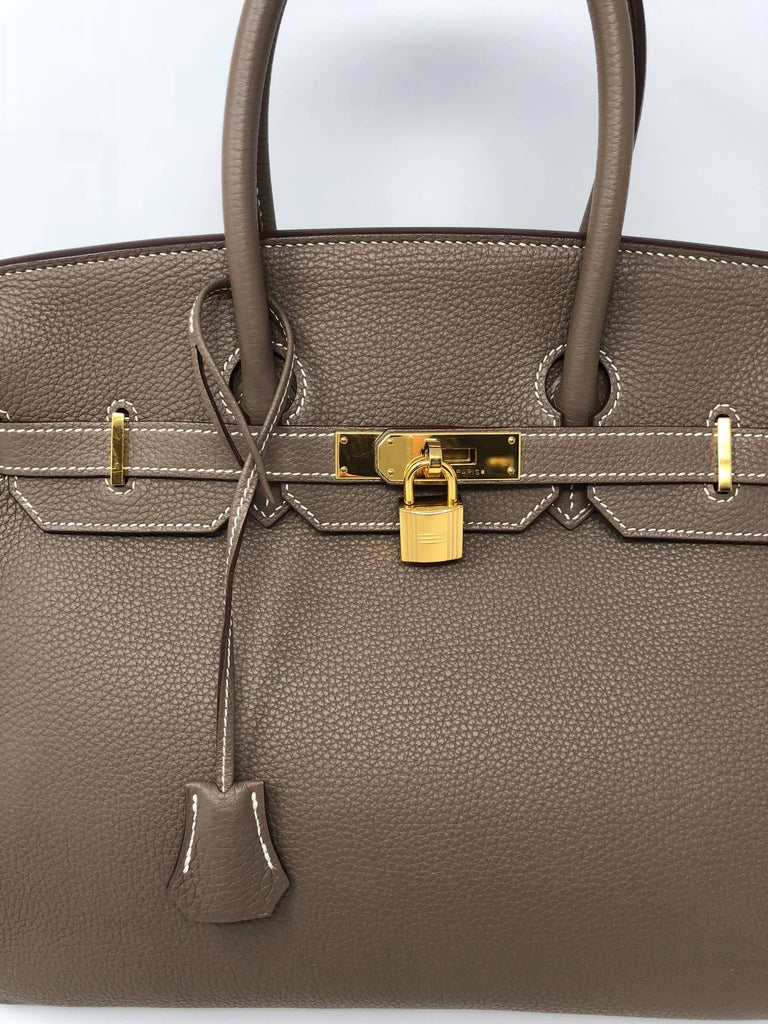 ba34a04d0564 This guaranteed authentic Hermes Birkin 35 is in Etoupe color and in Togo  leather. Most