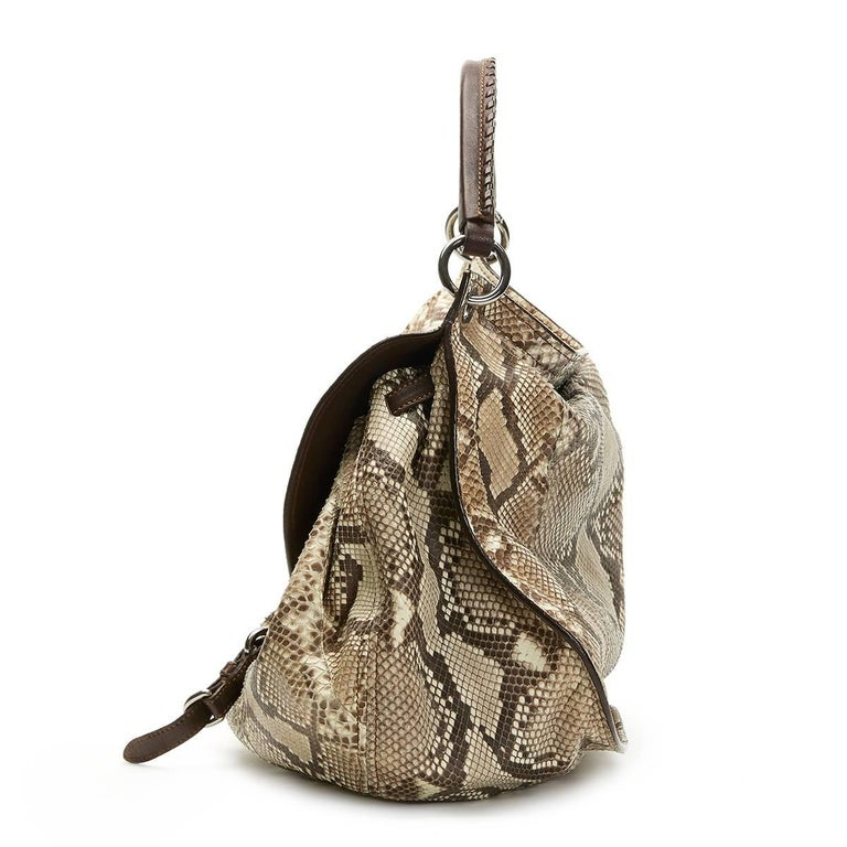 MIU MIU Python Leather Aviator Hobo Bag  Reference: CB114 Serial Number: 37 Age (Circa): 2011 Accompanied By: Miu Miu Dust Bag, Care Card, Shoulder Strap Authenticity Details: Serial Tag (Made in Italy) Gender: Ladies Type: Shoulder, Tote,