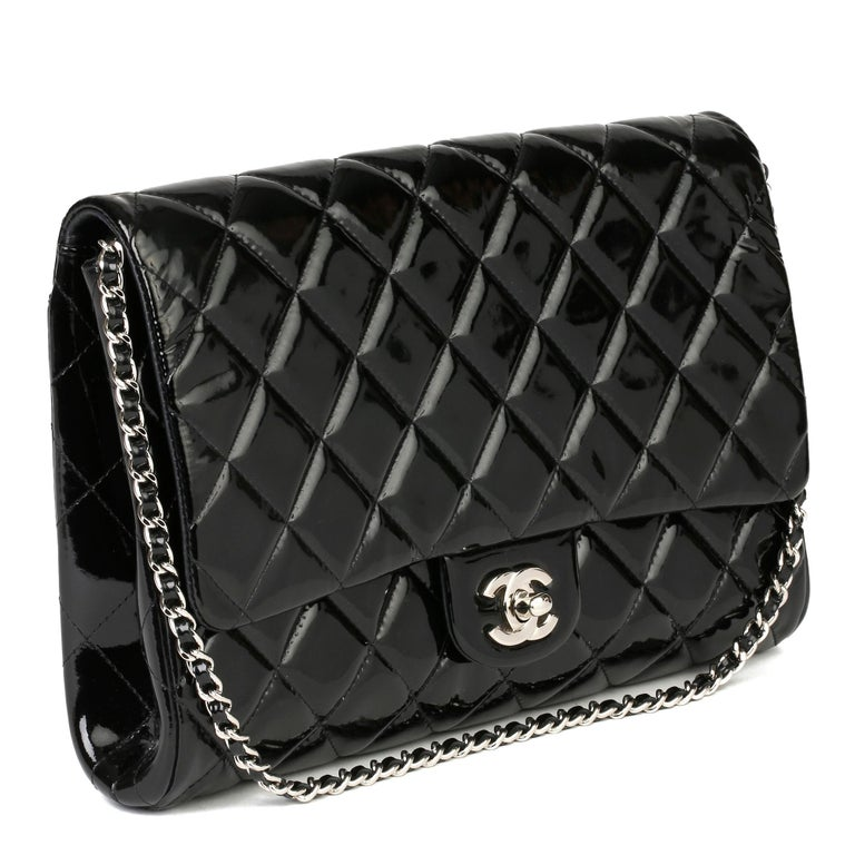 CHANEL Black Quilted Patent Leather Classic Clutch on Chain  Xupes Reference: HB3915 Serial Number: 17548973 Age (Circa): 2012 Accompanied By: Chanel Dust Bag, Authenticity Card, Care Booklet, Protective Felt Authenticity Details: Authenticity Card,