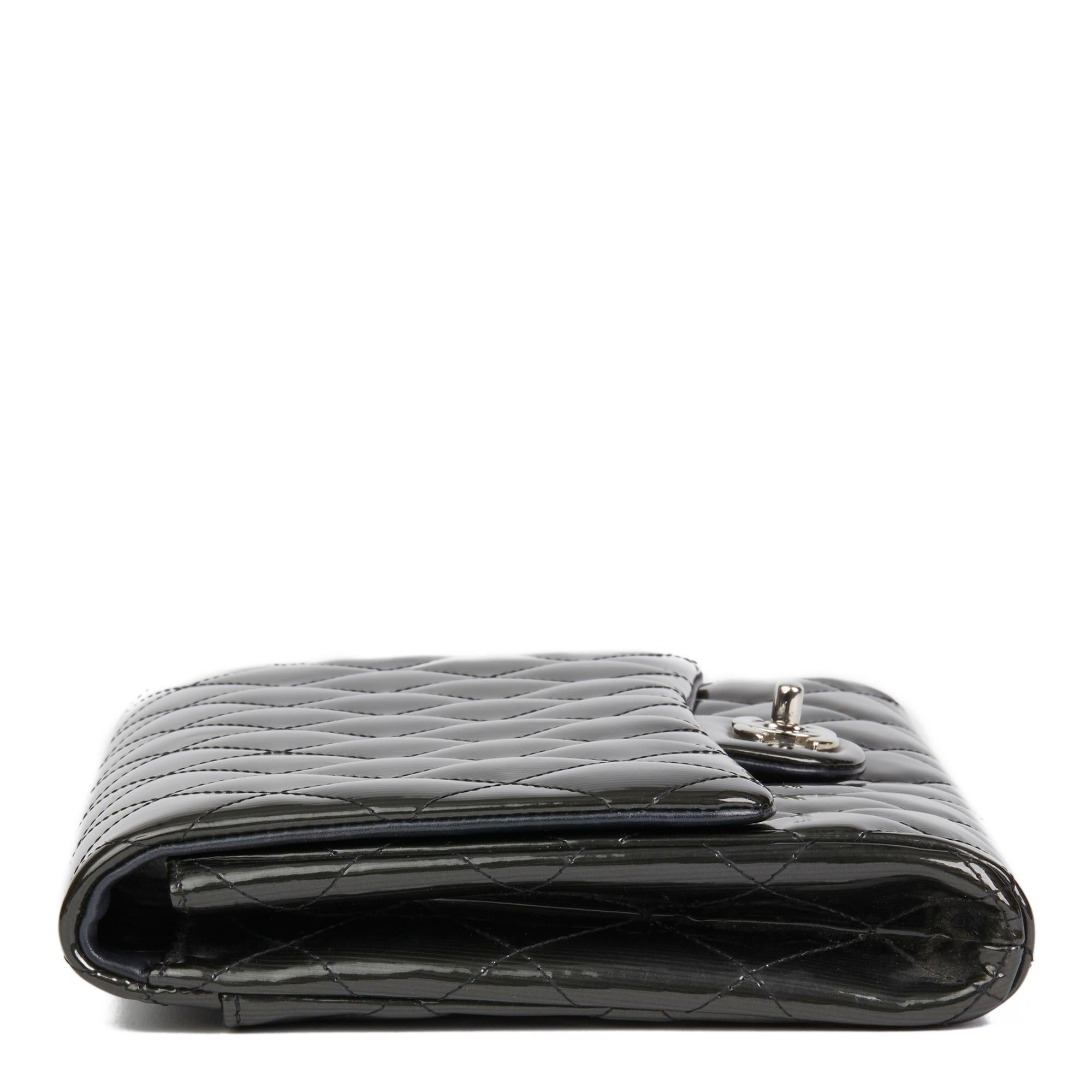bb75d5b699c336 2012 Chanel Black Quilted Patent Leather Clutch-on-Chain at 1stdibs
