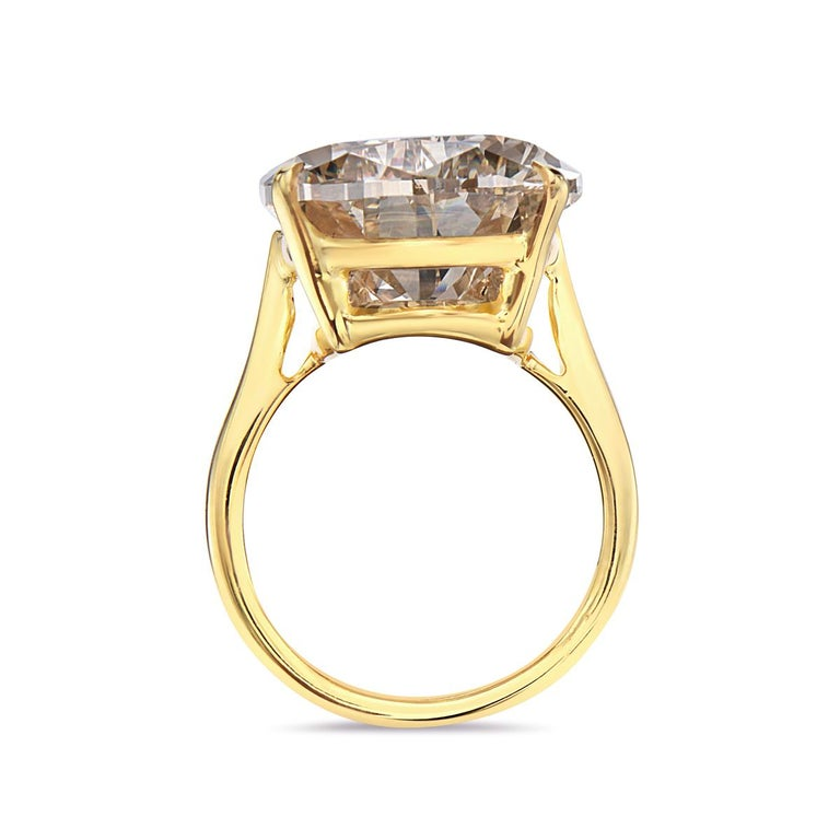 This GIA certified engagement ring features a 20.12 fancy brownish yellow pear shape VS2 diamond set in 18K yellow gold. Report No. 5151508190. Size 5.5.   Resizeable upon request and ring color could be changed to white or rose gold as