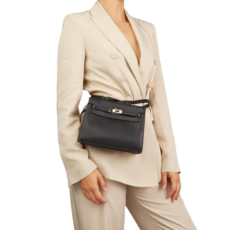 HERMÈS Black Swift Leather Kelly Danse  Xupes Reference: HB2901 Serial Number: [P] Age (Circa): 2012 Accompanied By: Hermès Dust Bag, Box Authenticity Details: Date Stamp (Made In France) Gender: Ladies Type: Shoulder, Crossbody, Backpack, Belt Bag,