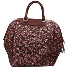 2012 Louis Vuitton North South Leo bag in leather and sequins